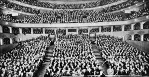 Yogananda giving a lecture at the Philharmonic Auditorum, Los Angeles, California.
